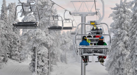 Ski chair lift with skiers. Ski resort in Ruka, Finland
