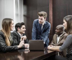 Businesspeople, teamwork. Group of multiethnic busy people working in an office